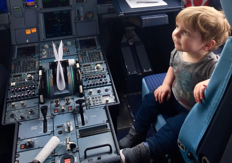 Amanda's toddler taking a look around in the cockpit. What a great way of traveling with toddler on plane!