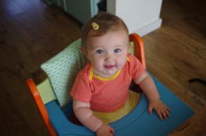 our daughter Norah is her high chair