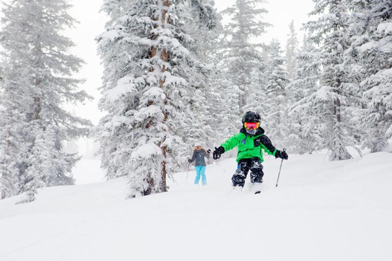 kids skiing down the mountain