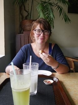 Babs eating scones in Malaysia