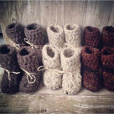 6 pair of white, grey and brown babywearing winter booties