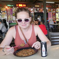 Kath eating baked rice in Malaysia