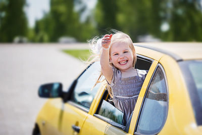toddler girl on the start of a roadtrip