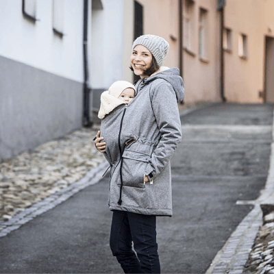 woman with baby wearing the grey Angel Wings Softshell Parka baby carrier winter jacket